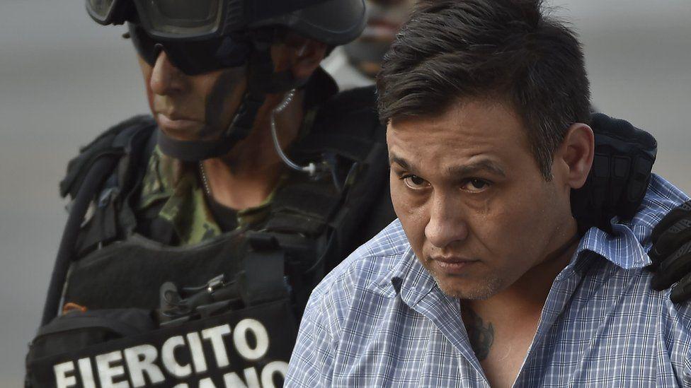 Omar Treviño Morales being taken under custody