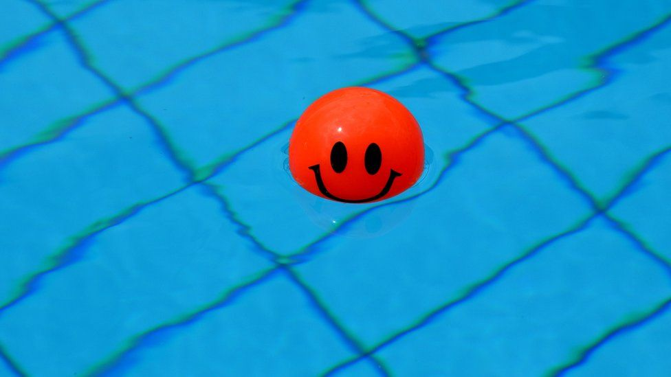 Bouncy ball in a swimming pool