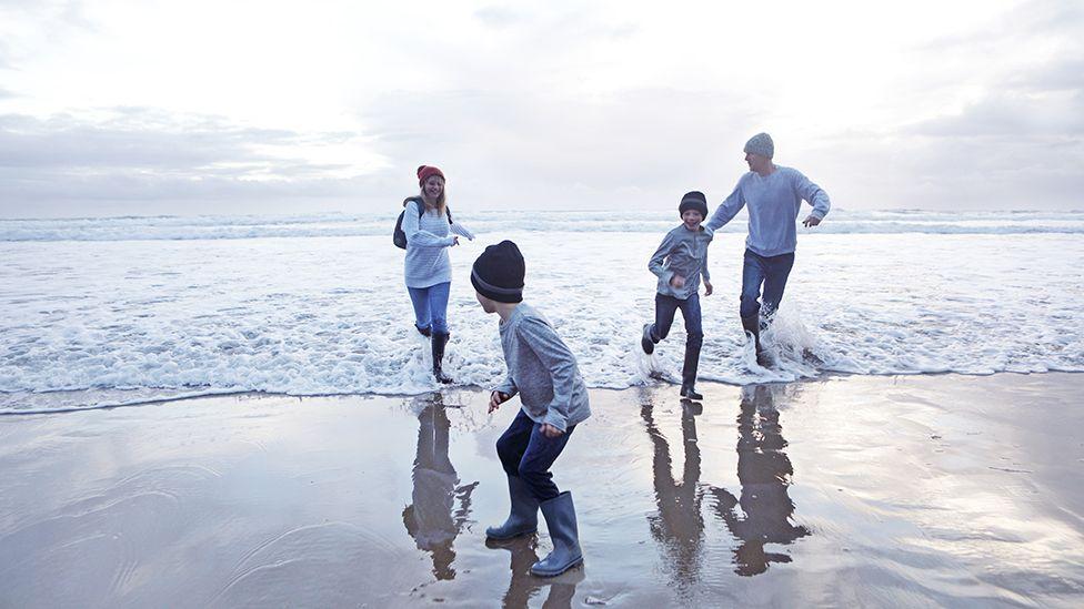Family on a beach in autumn