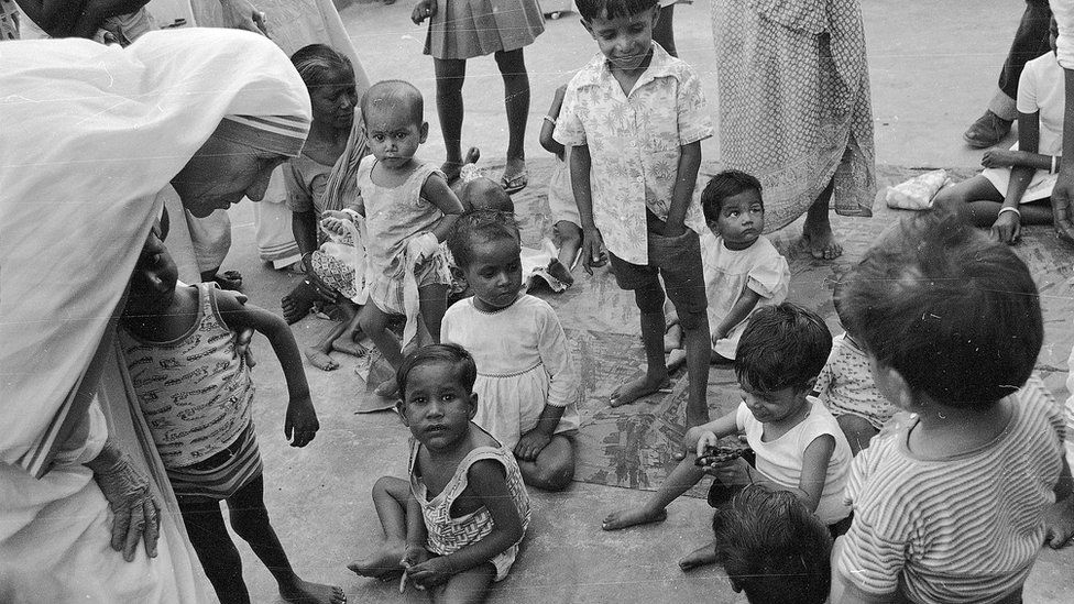 Mother Teresa talks with and blesses the orphans at her Sishu Bhavan (Children's Home) in Kolkata, India