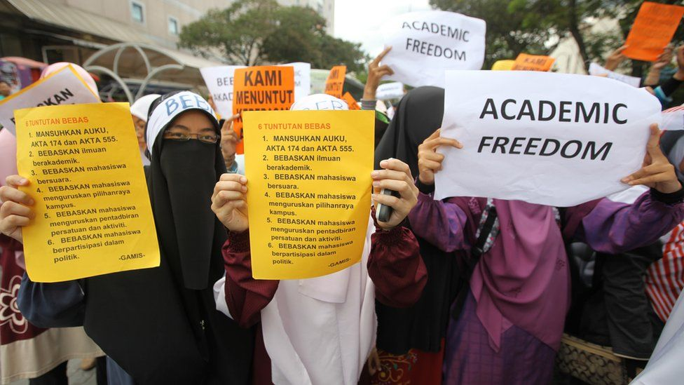 Students display placards reading 'Academic Freedom' during a protest in downtown Kuala Lumpur in 2011