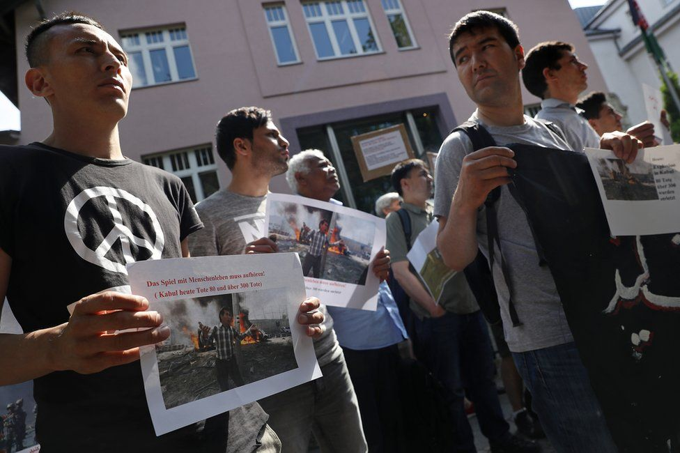 Afghans protest against deportations outside the Afghan embassy in Berlin, 31 May