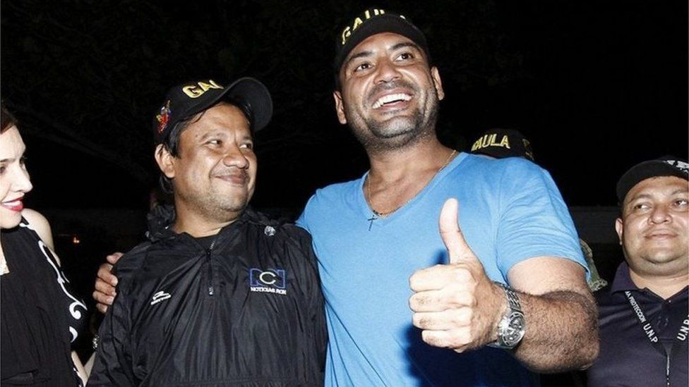 """Colombian journalists Carlos Melo (L) and Diego D""""Pablos (R), of television channel RCN, after they were freed by Colombian guerrilla group ELN in the Colombian region of Catatumbo, early 28 May 2016."""