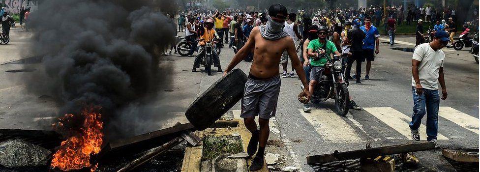 Anti-government activists build a barricade in Valencia