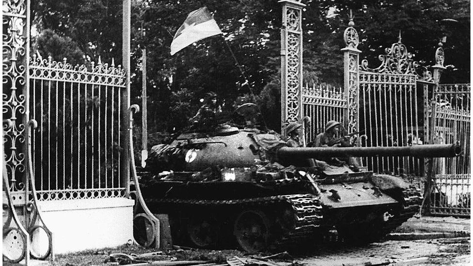 A North Vietnamese tank driving through the main gate of the presidential palace of the US-backed South Vietnam regime as the city falls on 30 April 1975.