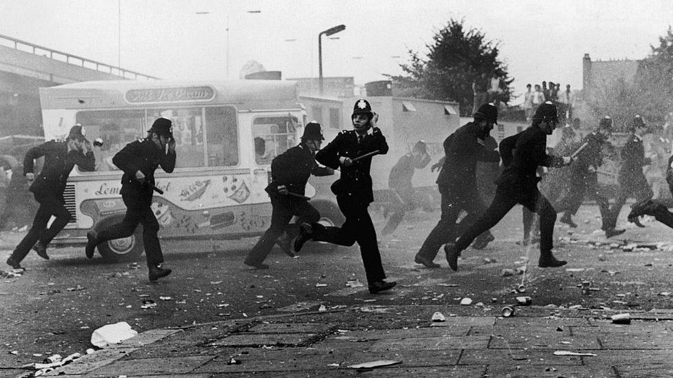 London police make a tactical withdrawal during the riots which followed the Notting Hill Carnival 1976