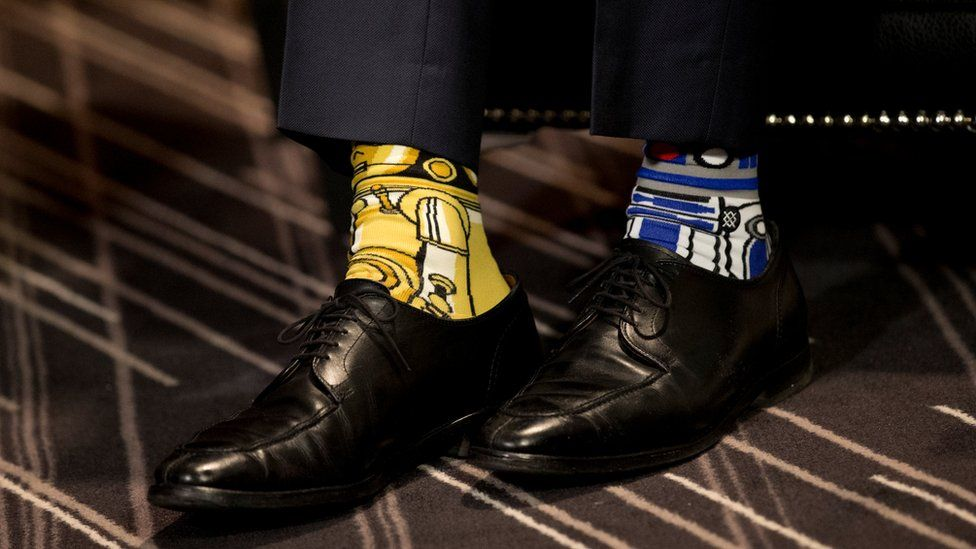 Canada's PM Justin Trudeau wears Star Wars-themed socks as he meets with his Irish counterpart, Taoiseach Enda Kenny, during a visit to Montreal, 4 May 2017
