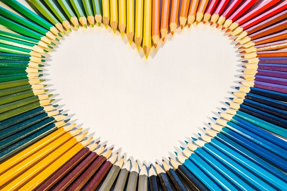 Rainbow heart made of pencils