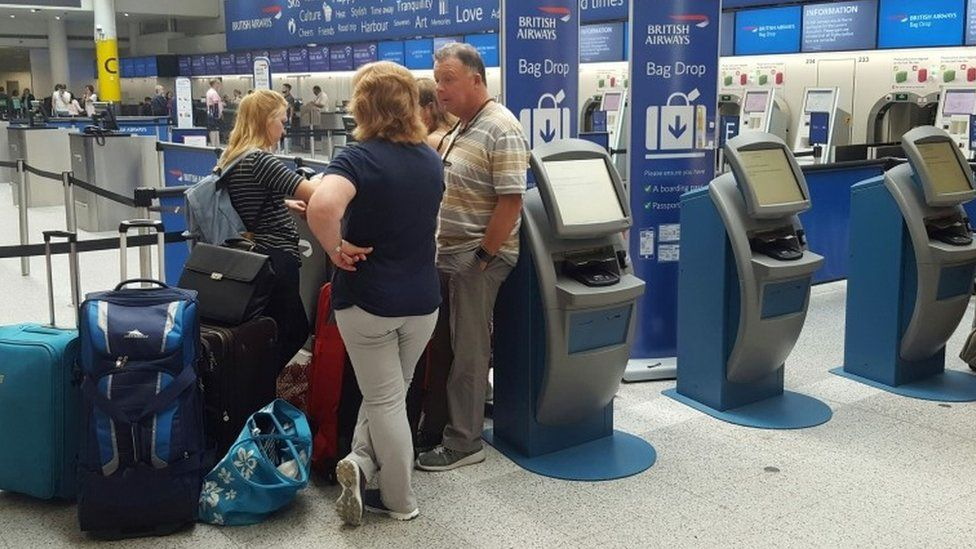 Passengers at the British Airways check-in desk at Gatwick Airport on 27 May.