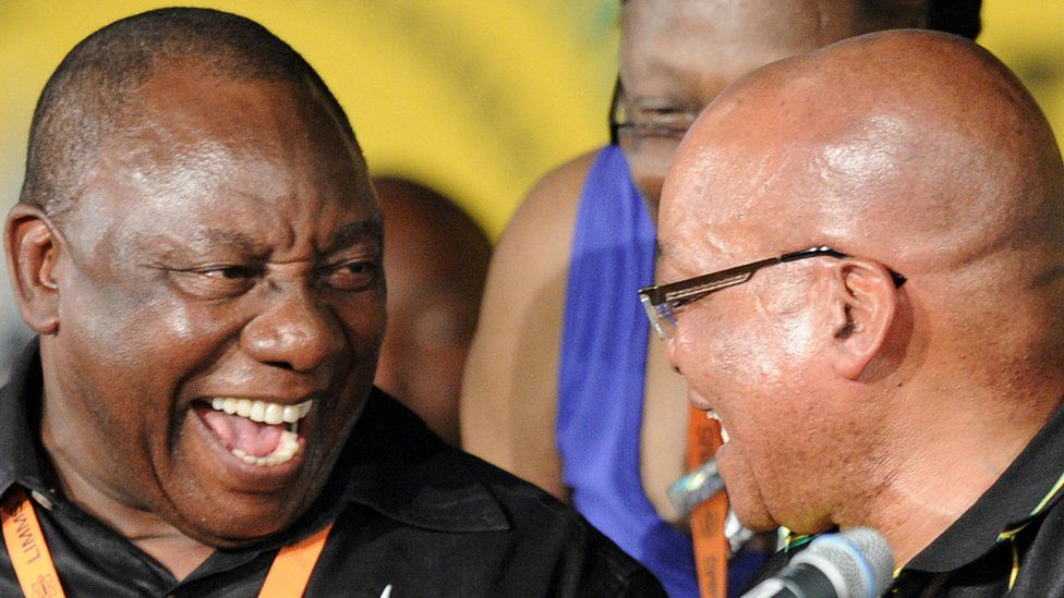 Newly elected deputy president of the African National Congress (ANC) Cyril Ramaphosa (L) talks with South African President and new reelected ANC president Jacob Zuma during the 53 rd National Conference of the ANC on December 18, 2012 in Bloemfontein.