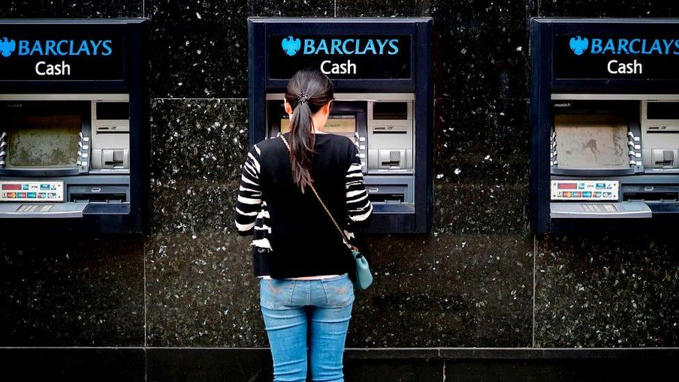 Woman at Barclays cash point