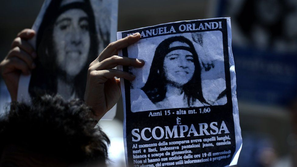 """A demonstrator holds a poster of Emanuela Orlandi reading """"Missing"""" in St. Peter's Square, at the Vatican on May 27, 2012"""