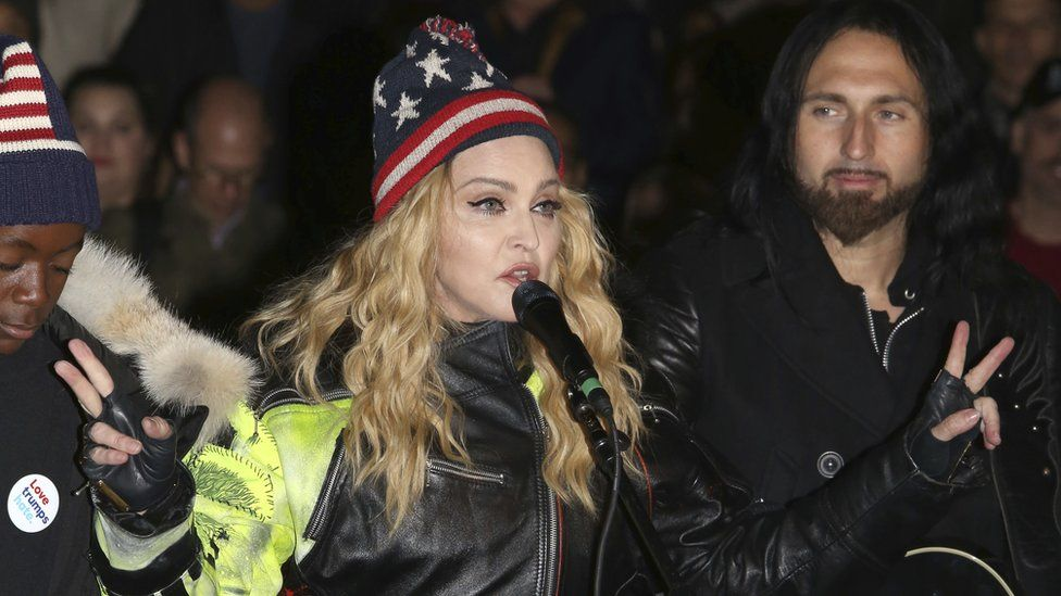 Madonna performing in support of the Democratic presidential candidate Hillary Clinton at Washington Square Park