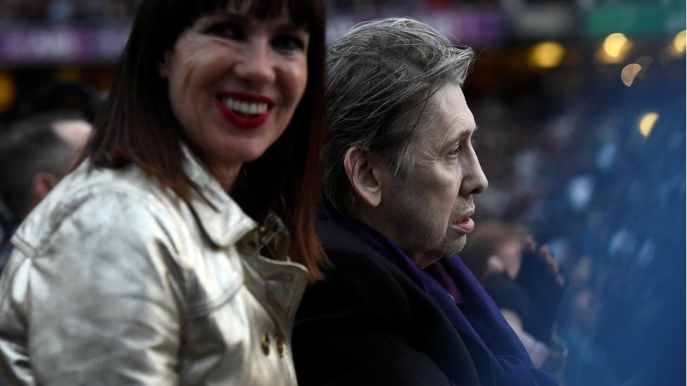 The Pogues singer Shane MacGowan watches on as U2 perform at Croke Park