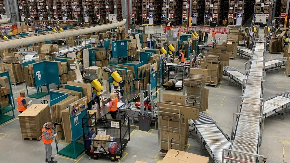 Workers in an Amazon warehouse