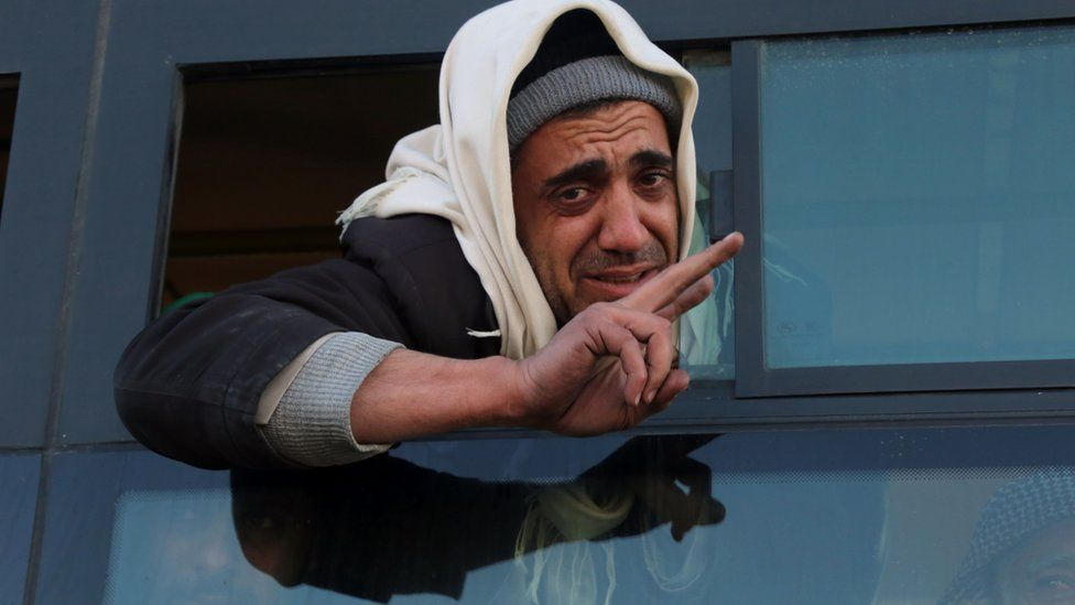 A Syrian man, who was evacuated from rebel-held neighbourhoods in the embattled city of Aleppo, gestures as he arrives in the opposition-controlled Khan al-Aassal region, west of the city