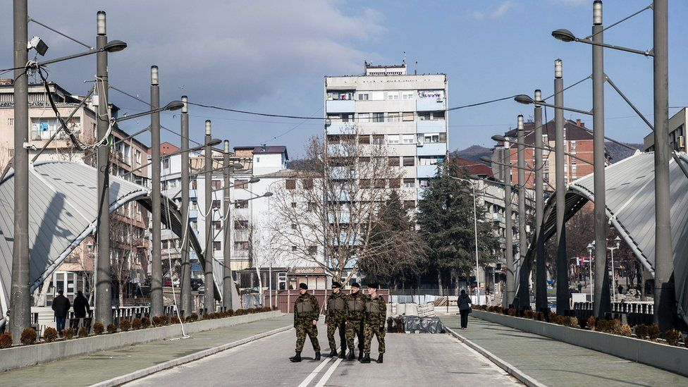 Nato-led peacekeepers on the main bridge in Mitrovica in Feburary 2018