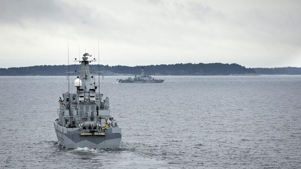 Swedish minesweeper HMS Kullen (L) is engaged in a military operation in the Stockholm Archipelago, Sweden, 19 October 201