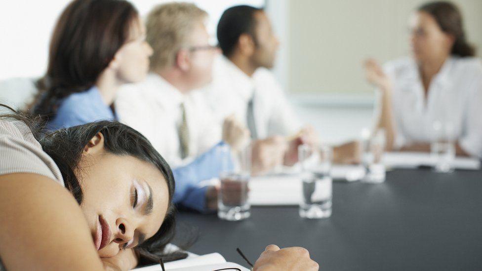 Businesswoman asleep in meeting