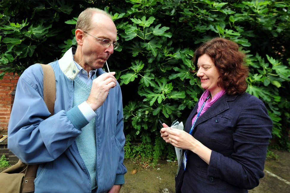 Dr Turi King from Leicester University gives Michael Ibsen, a 17th generation great nephew of Richard III, a DNA swab at Greyfriars car park in Leicester during an archaeological search for the lost grave of Richard III, 24 August 2012