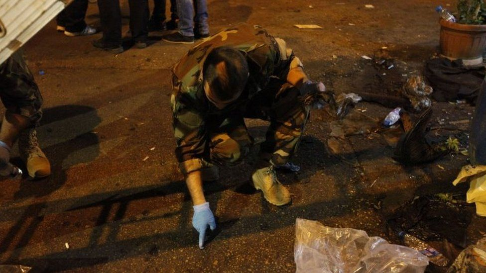 Lebanese army forensics officer gather evidence at the site of a twin suicide bombing in Burj al-Barajneh, Beirut (12 November 2015)