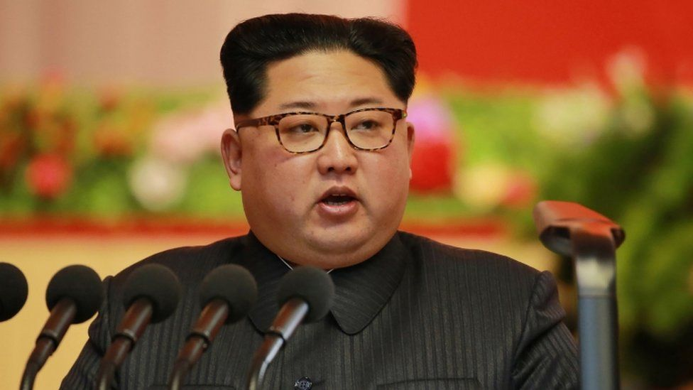 Kim Jong-Un in an image released by North Korean news agency on December 12, speaking into microphone at a munitions conference