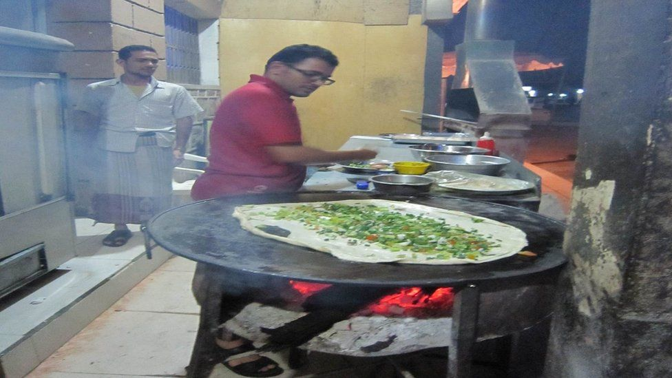 A Yemeni chef preparing a dish.