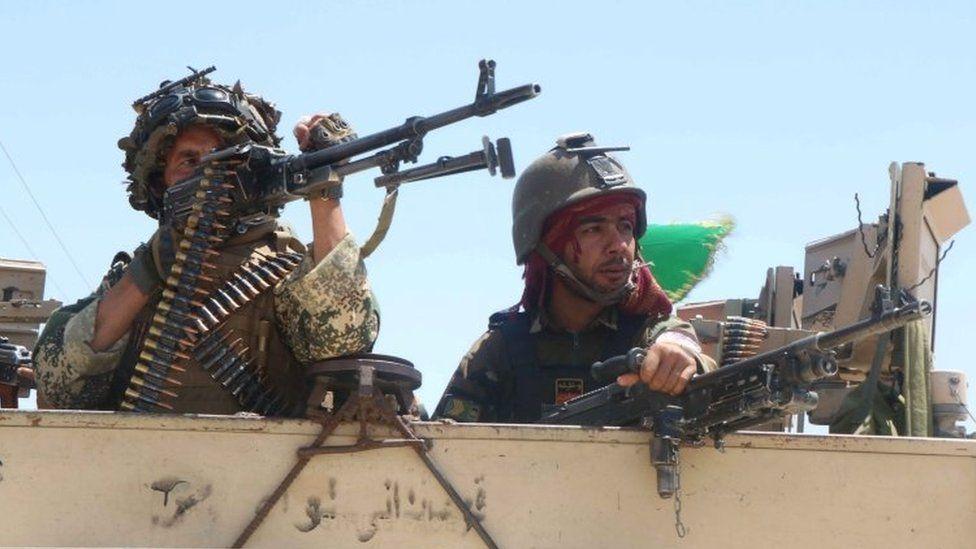 Afghan security forces patrol in Herat