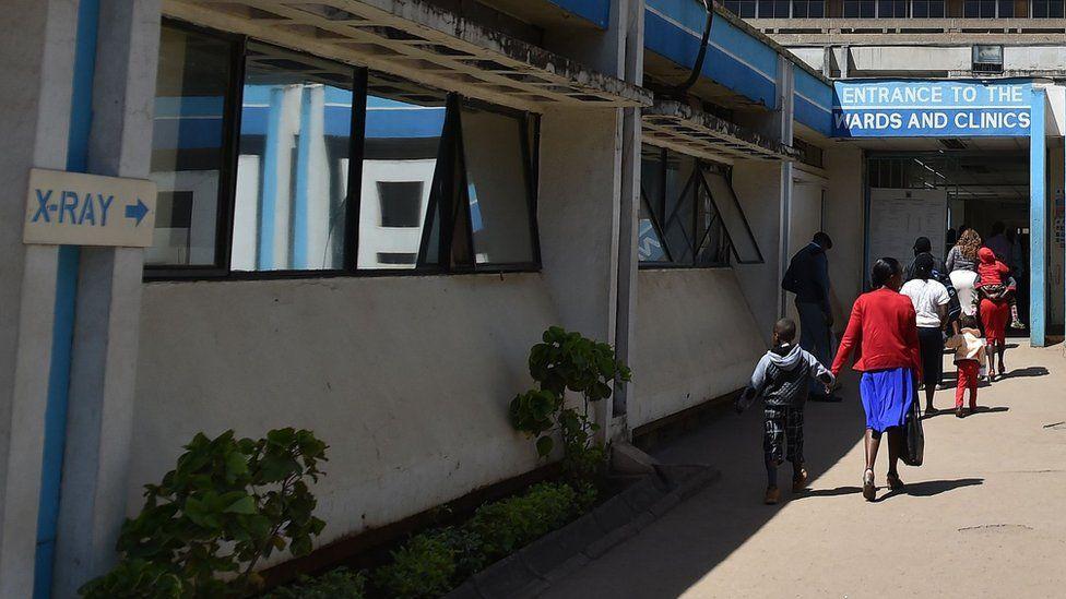 People walk in front of Kenya's oldest hospital, Kenyatta National Hospital (KNH) in Nairobi on 23 January 2018
