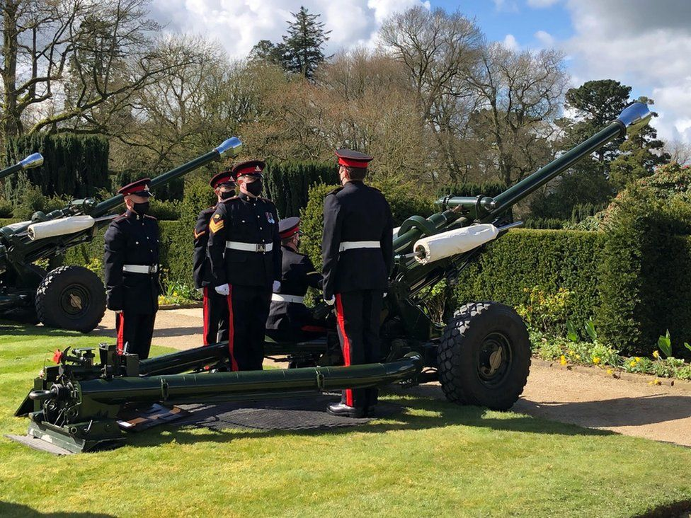 Military personnel wore black face coverings for the gun salute at Hillsborough Castle in County Down.
