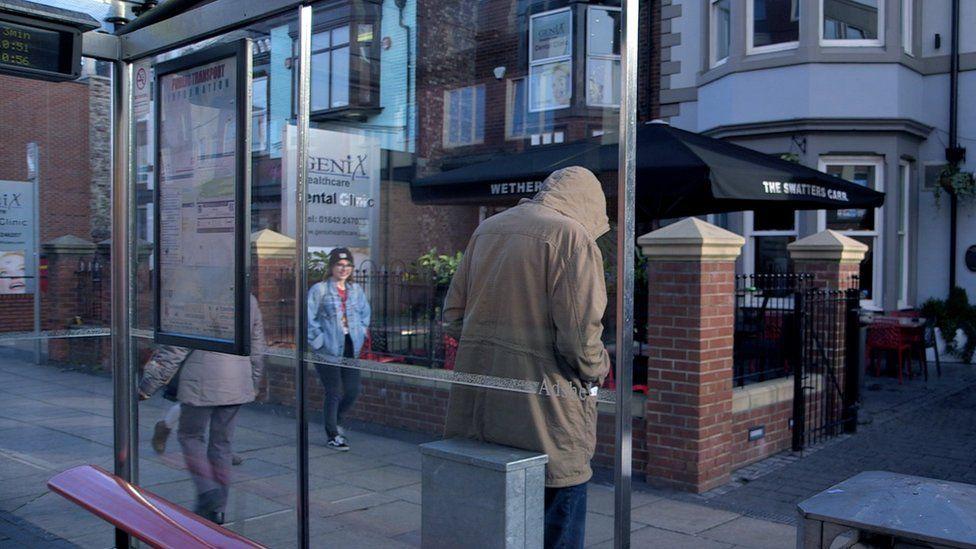 Bradley Grimes at bus stop