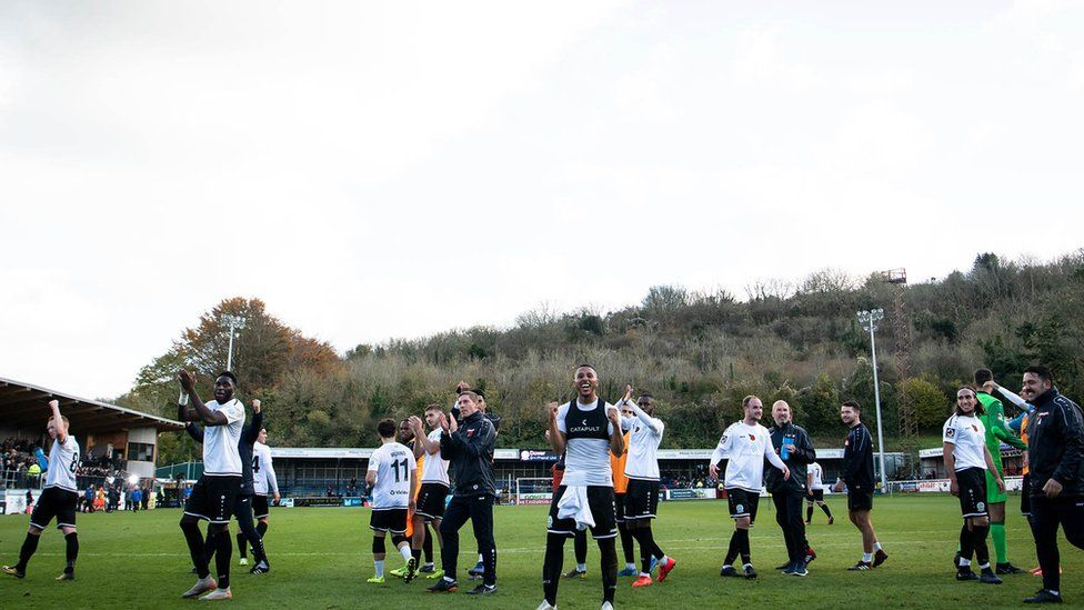 Dover players celebrate at the final whistle