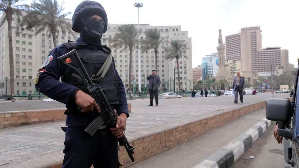 Member of the Egyptian security forces stands guard on Tahrir Square in Cairo