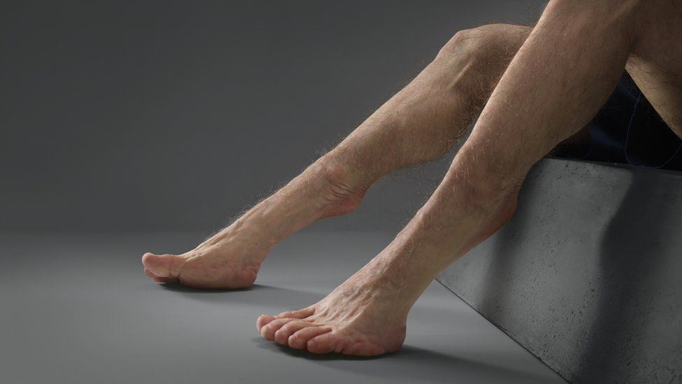 Legs of the sculpture nicknamed Graham