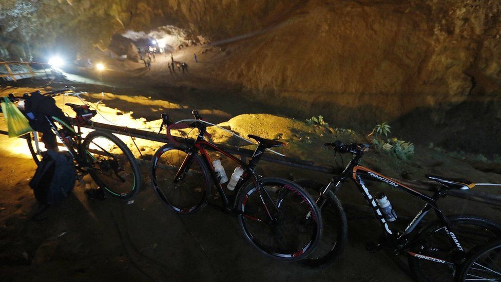 Bicycles and backpacks from the boys outside the cave