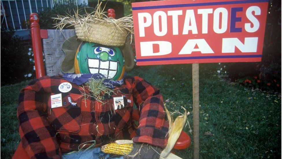 An effigy of Dan Quayle and a sign with the words 'Potatoes Dan'