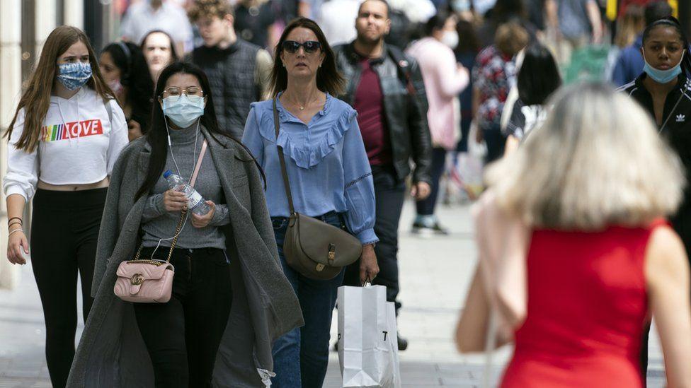 Shoppers wearing masks in Oxford Street, London