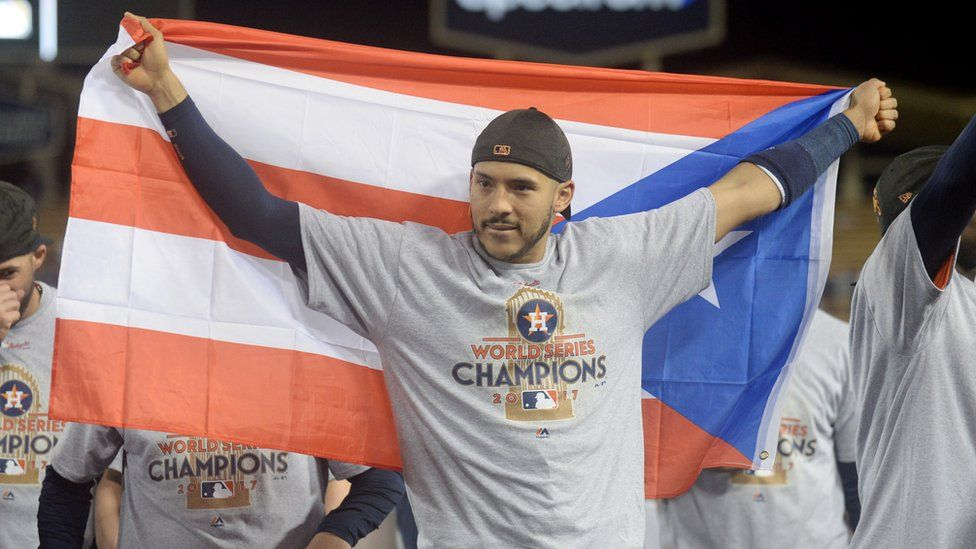 Houston Astros shortstop Carlos Correa celebrating with the Puerto Rico flag