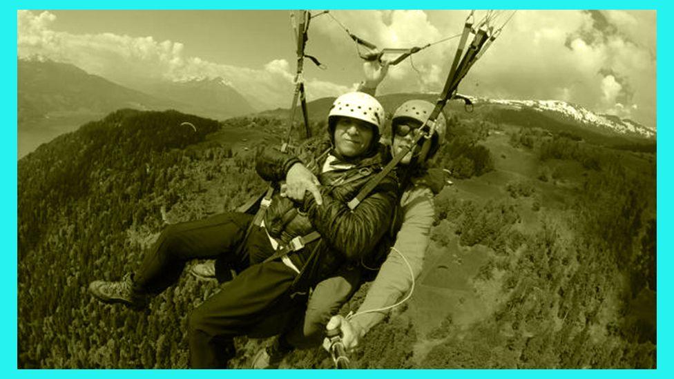 Zain and his dad paragliding