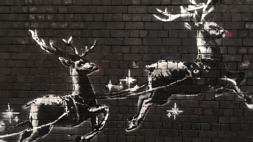 The Banksy artwork with red noses