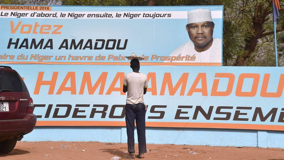 A campaign poster for presidential candidate Hama Amadou ouside Amadou party's headquarters in Niamey