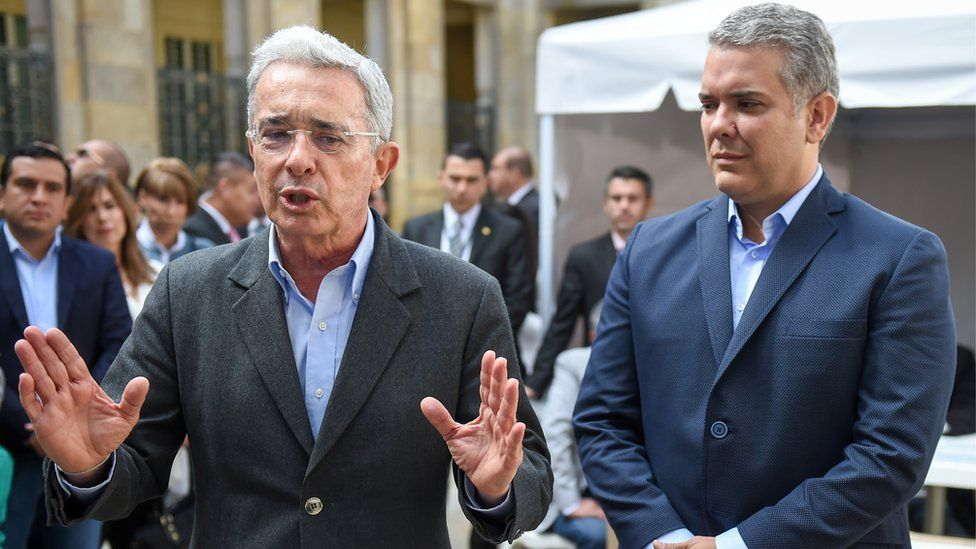Ivan Duque and Álvaro Uribe (left)