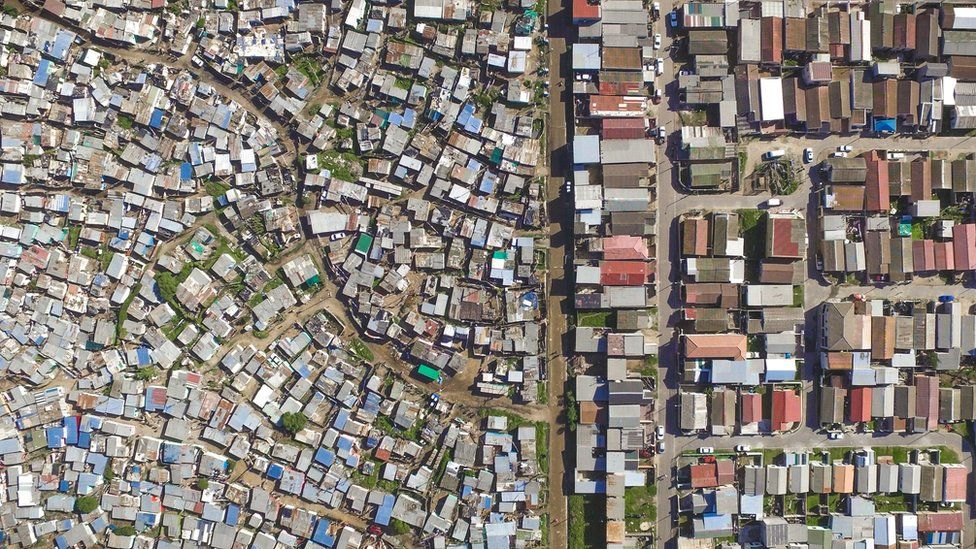 aerial photos reveal the stark divide between rich and poor bbc news