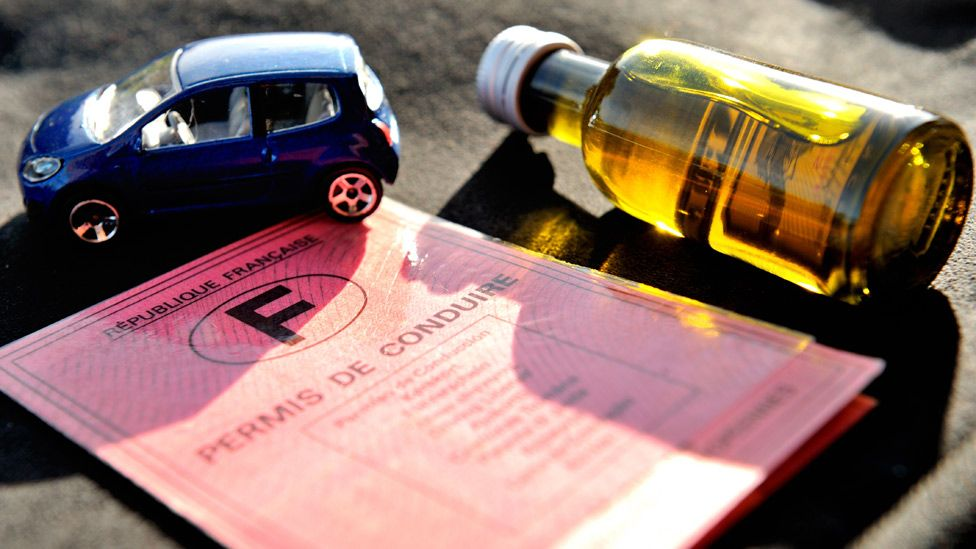 A French driving licence, a bottle of pastis and a small car