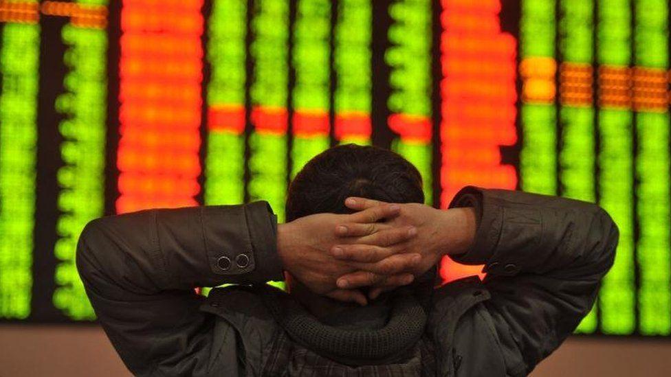 Investor looking at shares screen 4/1/16