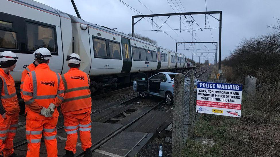 Car and train on tracks
