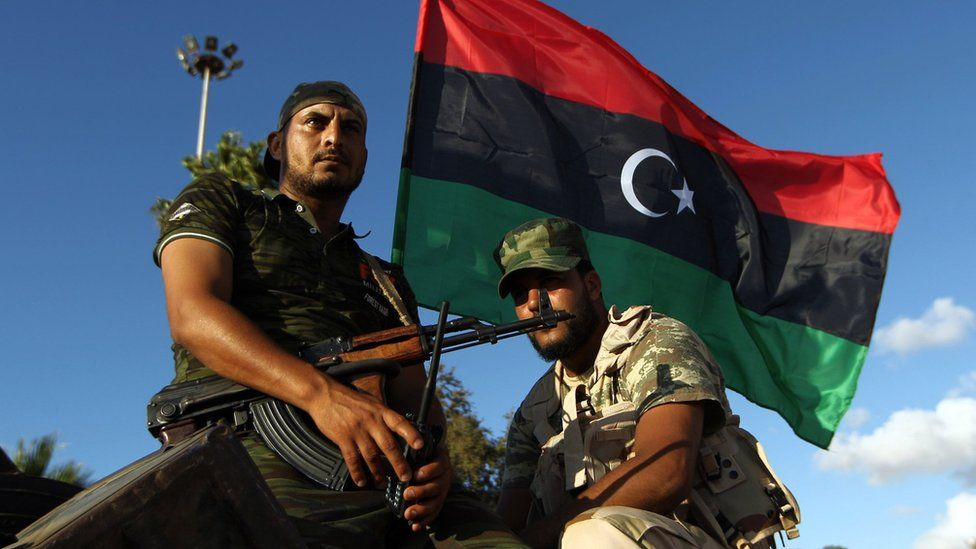 Libyan troops loyal to Khalifa Haftar sit on an APC in Benghazi, August 2015