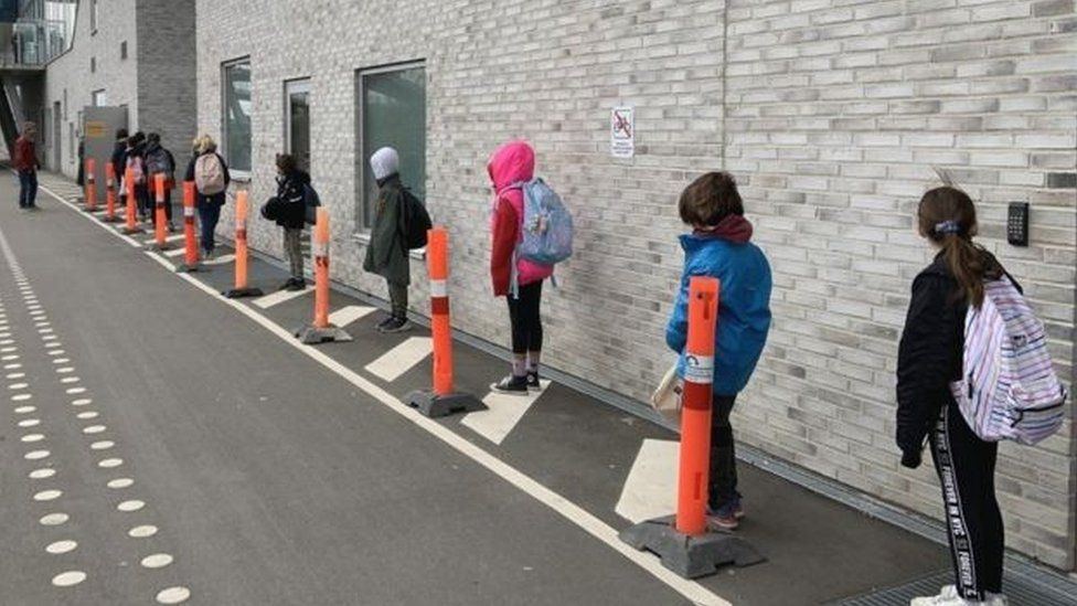 children social distancing at school