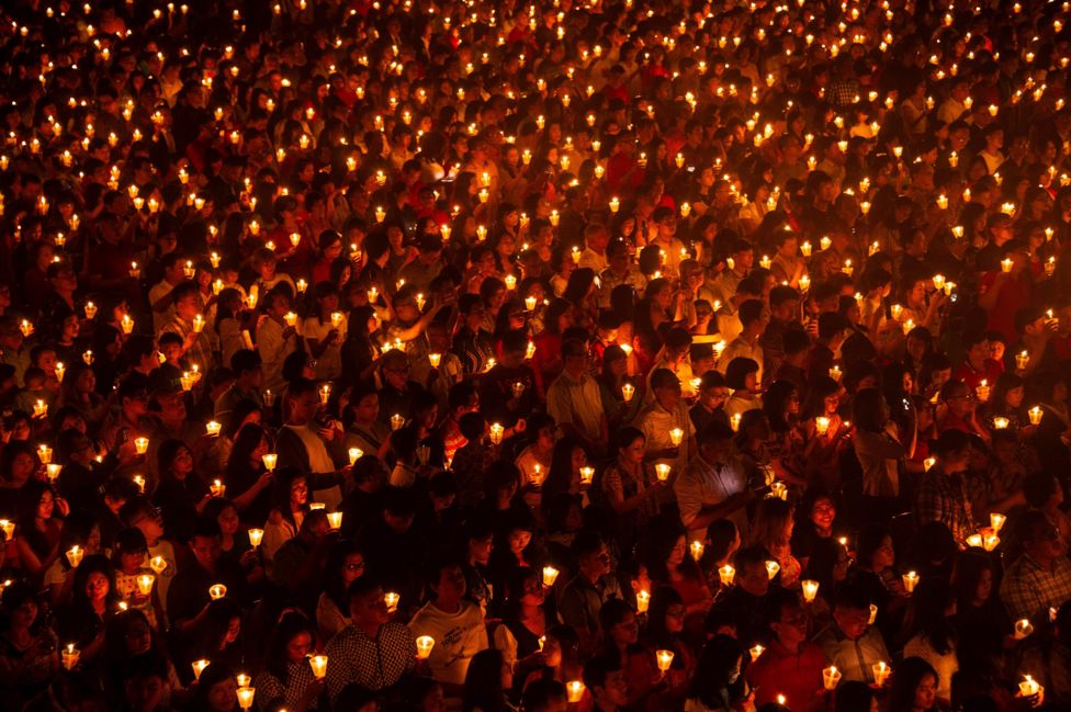 "Indonesian Christians attending mass on Christmas Eve at a stadium in Surabaya, the country""s second largest city"