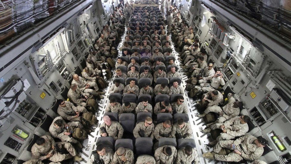 US troops on board a transporter plane in Afghanistan
